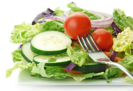 cucumbers: Fresh garden salad with lettuce onion tomato cucumber on white background. Stock Photo