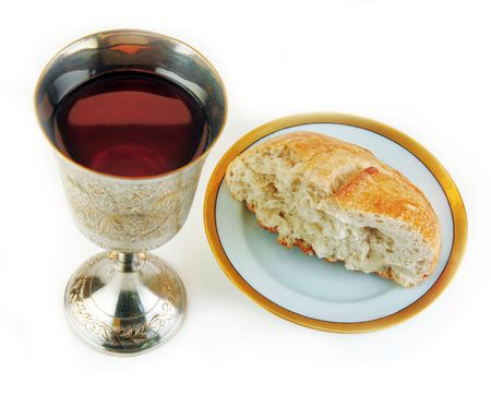 devout: Communion bread and wine on a white surface. Stock Photo