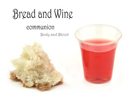 Communion bread and wine on a white surface. Imagens