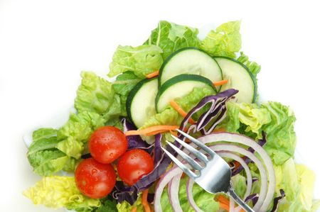 Fresh garden salad with lettuce onion tomato cucumber on white background. Stock Photo