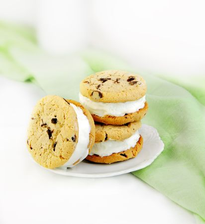 Chocolate chip cookie and ice cream sandwiches on green and white background. Stock Photo