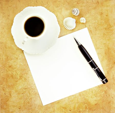 Coffee with pen and paper blank for your text on a tan background. Stock Photo - 4909471