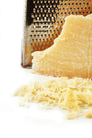 Parmesan cheese freshly grated on a white background. photo