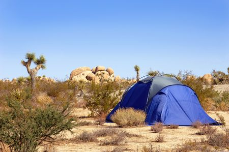 Camping tent set up in the Mojave Desert. photo