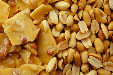 Peanut brittle and nuts perfect as a background.
