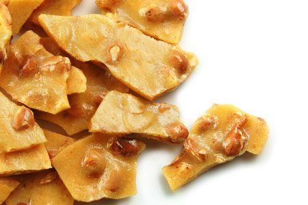 brittle: Homemade peanut brittle on a white background