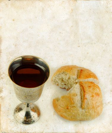 Communion bread and wine on a grunge background.