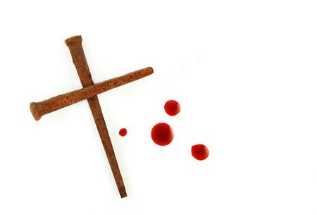 Rusty Nails Forming a Cross and drops of blood on a white background. photo
