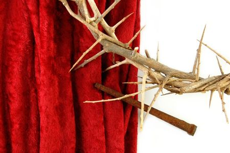 rusty nail: Crown of Thorns with metal spike on red background. Stock Photo