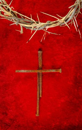 Nail spike cross with a crown of thorns. Stock Photo