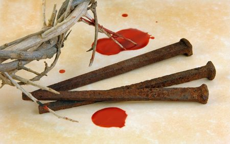 rusty nail: Crown of Thorns with metal spikes and blood drips.