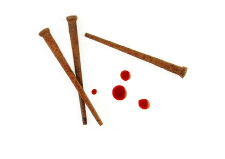 nails: Rusty Nails and drops of blood on a white background.