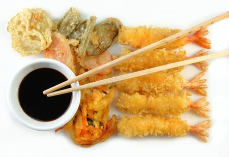 Shrimp Vegetable Tempura and chopsticks on a white plate.