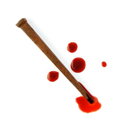 Rusty nail and drops of blood on a white background.