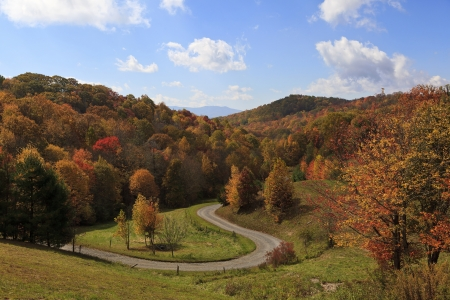 A curvey, gravel road in the mountains in the fall