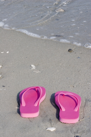 Sandals in the Beach Sand photo