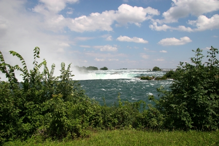 niagara river: Niagara River and the Falls in the Background Stock Photo