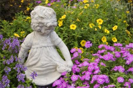 statuary: Little Girl Statuary and Flowers