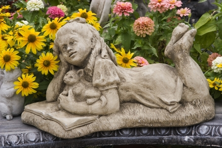 Little Girl Statuary and Flowers