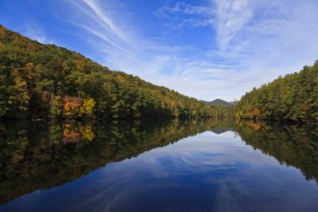 graham: Santeetlah Lake in Graham County in North Carolina with pretty sky and cloud reflections