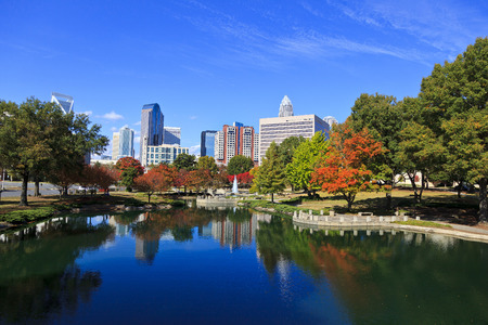 Charlotte skyline from Marshall Park in the fall. The new Skye condos are in the middle. Stock Photo