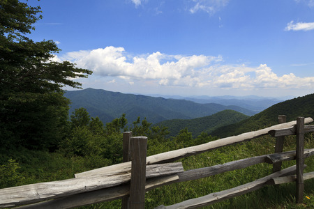 split rail: Blue Ridge Mountains in the spring with split rail fence in foreground Stock Photo