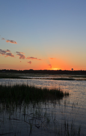 swampy: Sunset on the Canal in South Carolina at Cherry Grove Beach Stock Photo