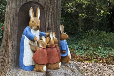 Peter Rabbit Scene of Wood Bunny Sculptures