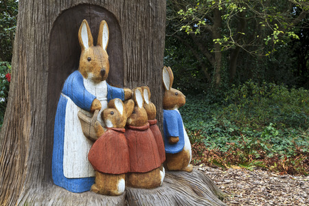 Peter Rabbit Scene of Wood Bunny Sculptures