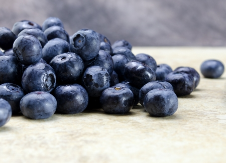 counter top: fresh ripe blueberries on tan kitchen counter top