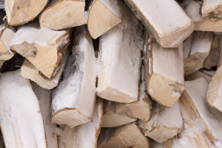 Stack of firewood covered in snow Stock fotó