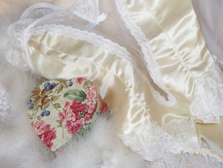 White satin and lace lingerie with pink floral heart Reklamní fotografie