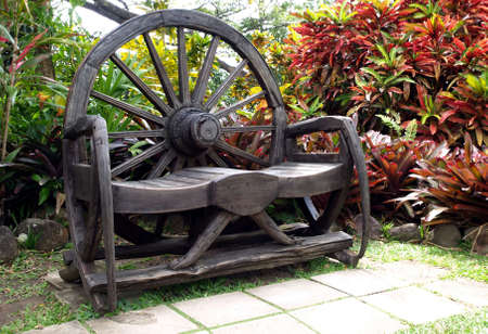 An inviting rustic wooden bench in an outdoor garden Stock Photo - 4601817
