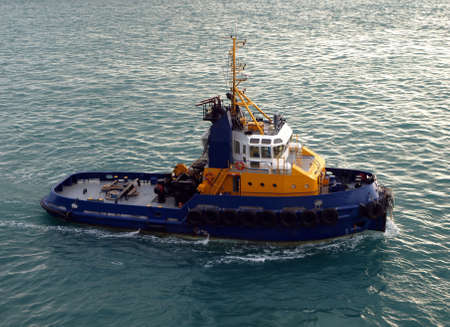 A blue and yellow pilot boat stands ready to lead and assist Reklamní fotografie