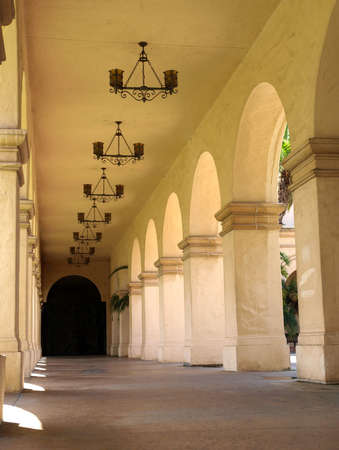 An exterior mission style walkway with arched design