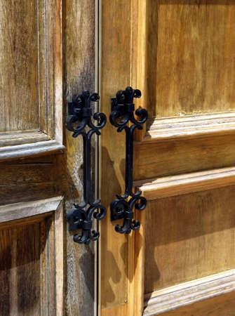 Weathered wooden double doors with iron metal handles Reklamní fotografie