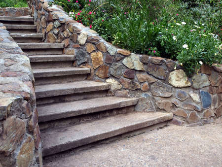 A cascading stone staircase surrounded by lush foliage