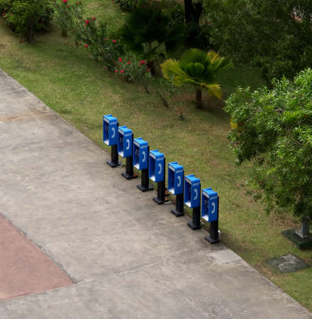 A grouping of empty blue pay phone booths