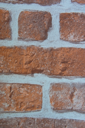 coverings: orange tone brick with white concrete wall coverings Stock Photo