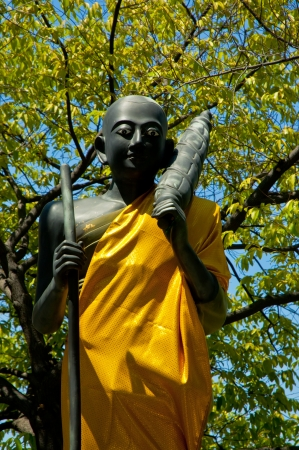 The Half length Buddha statue on nature background Stock Photo - 18635767