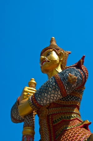 half lenght traditional thai style sculpture on blue sky