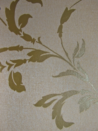 coverings: gold tone flower textile wall coverings pattern Stock Photo