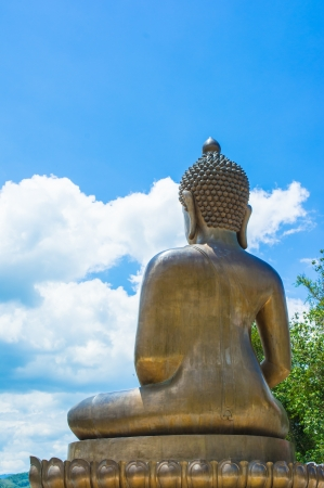 back view big Buddha statue of thailand on natural backgrounds photo