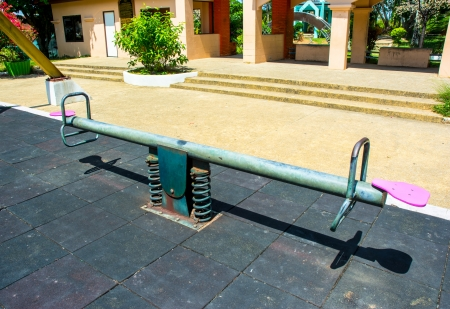 old steel seesaw in child park photo