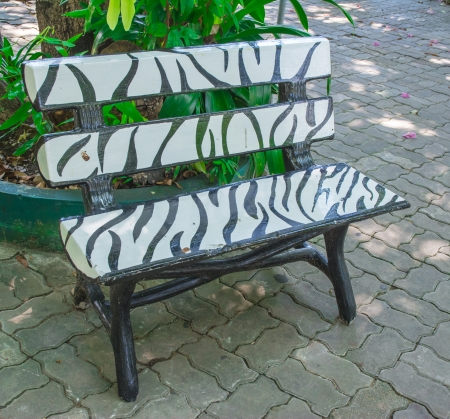 black and white wooden paint chair on nature park photo