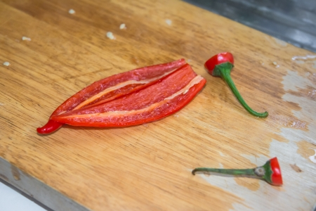 red peel Paprika peppers on wood butcher photo