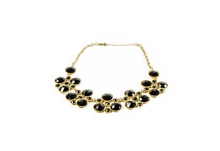 dark tone gem and gold necklace isolated on white background photo