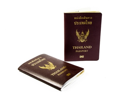 two passport book of thailand isolated on white backgrounds photo