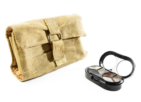 single fabric cosmetic bag and make up object isolated photo