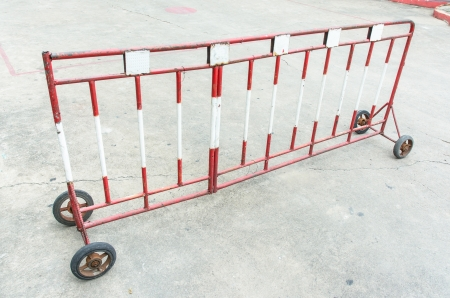 old steel palisade with wheels for safe at car park photo